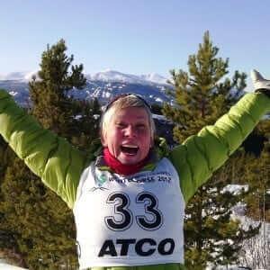 Christine Klaassen St. Pierre finishes a joyful snowshoe race on top of a snowy Canadian mountain.