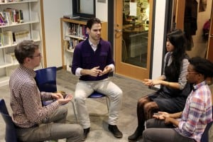 Alan Brown teaches mindfulness to three high school students.
