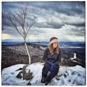 Erica Marcus sits on top of a snowy hill